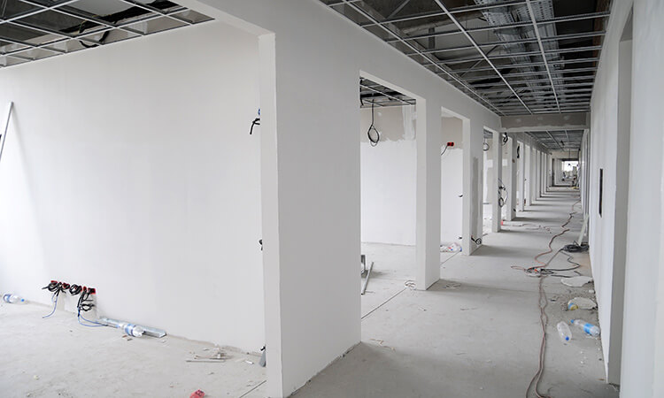Drylining of interior partition walls